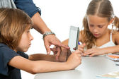 Teachers hand pointing on kids tablet. — Stock Photo