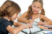 Two kids doing homework on digital tablet. — Stock Photo