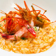 Creamy risotto rice dish with red prawns. - Stock Photo