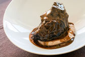 Appetizing roasted neef with dark gravy. — Stock Photo