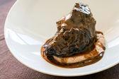 Appetizing roasted neef with dark gravy. — Stock Photo
