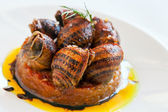 Close up snail starter with tomato. — Stock Photo