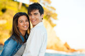 Handsome young couple at seaside. — Stock Photo