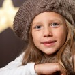 Close up of cute girl wearing beanie. - Stok fotoğraf