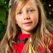 Cute blond girl holding golden candle. — Stockfoto