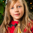 Cute blond girl holding golden candle. — Stok fotoğraf