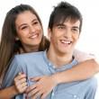 Smiling teen couple isolated. — Stock Photo