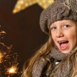Sweet girl having fun with fireworks. — Stock Photo