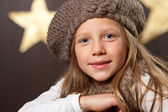 Close up of cute girl wearing beanie. — Stock Photo