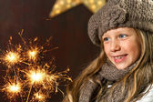 Cute girl looking at festive fire sparks. — Stock Photo