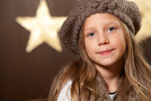 Portrait of cute girl wearing slouchy beanie. — Stock Photo