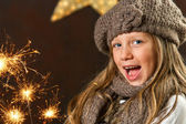 Sweet girl having fun with fireworks. — Stock Photo