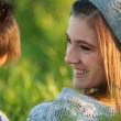 Attractive young girl smiling at boyfriend. — Stock Photo #17692891