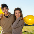 Cute teen couple outdoors with balloons. — Stock Photo #17693061