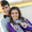 Portrait of handsome young couple in countryside. — Stock Photo