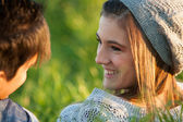Attractive young girl smiling at boyfriend. — Stock Photo