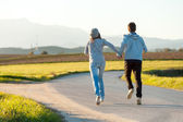 Couple running outdoors. — Stock Photo
