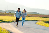 Teen couple running in countryside. — Stock Photo