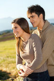 Young couple outdoors in rural field. — Stock Photo