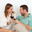Couple enjoying a glass of red wine at home. — Stock Photo
