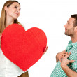 Couple fooling around with heart sign. — Stock Photo