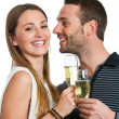 Hansome couple making a toast with champagne. — Stock Photo