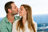 Boyfriend kissing girl on nose. — Stock Photo