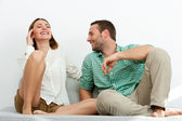 Handsome couple relaxing on sofa. — Foto Stock
