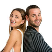 Smiling couple with backs together. — Stock Photo