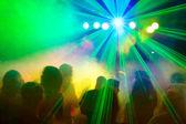 Crowd dancing under disco laser beam. — Stock Photo
