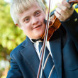 Cute handicapped boy playing violin. — Stockfoto