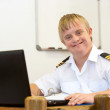Portrait of young pilot with down syndrome at desk. — Stock Photo