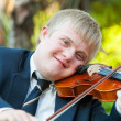 Portrait of young handicapped violinist. - Stok fotoğraf