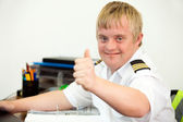 Young handicapped pilot showing thumbs up in office. — Stock Photo