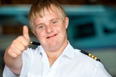 Young handicapped pilot showing thumbs up. — Stock Photo