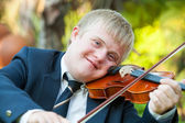 Portrait of young handicapped violinist. — Stock Photo