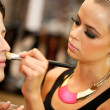 Stock Photo: Attractive female make up artist at work.