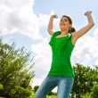 Happy girl jumping outdoors. — Stock Photo