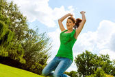 Euphoric girl jumping in park. — Stock Photo