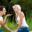 Boyfriend blowing kiss to young woman outdoors. — 图库照片