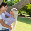 Young couple embracing under tree. — Stock Photo #22237881