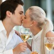 Cute couple kissing at dinner table. — 图库照片 #22239047
