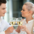 Cute couple celebrating event with wine. — Zdjęcie stockowe