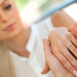 Extreme close up of girls hand with engagement ring. — Stock Photo