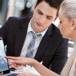 Businesswoman showing work to partner. — Stock Photo