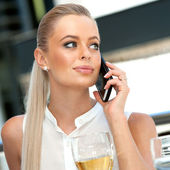 Female executive talking on smart phone at restaurant. — Stock Photo