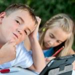 Boy struggeling with homework. — Stock Photo