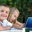 Young boy showing tablet with copy space. — Stock Photo