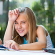 Portrait of cute girl at homework desk. — Stock Photo