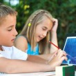 Cute boy resolving math game on tablet. — Stock Photo